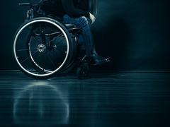 Woman invalid girl sitting on wheelchair Stock Photos