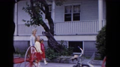 1961: building banner trees brick wall fence white huge water trees MICHIGAN Stock Footage