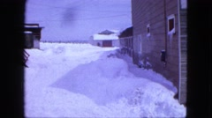 1963: heavy snow blankets the alleyways of a small grouping of buildings MAINE Stock Footage