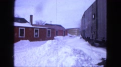 1963: houses and street is covered with snow MAINE Stock Footage
