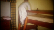 Young boy shows off the bunk beds in his room, 3691 vintage film home movie Stock Footage