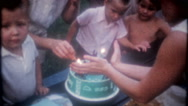 Children gather for a birthday party for young boy, 3686 vintage film home movie Stock Footage