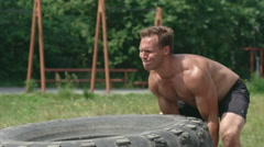 Building Power through Tire Workout Stock Footage