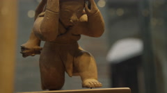 Ecuadorian art - ancient hunter statue Stock Footage