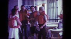 1963: five people wearing life jacket standing in the room and chatting MAINE Stock Footage