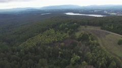 Forward flight above forest towards a lake Stock Footage