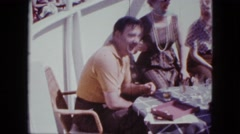 1963: a group of people are sitting at a table playing a game and singing a song Stock Footage
