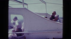 1963: people watching from deck of cruise ship on a bright and sunny day MAINE Stock Footage