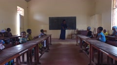School Teacher and students in Africa village - Guinea Stock Footage
