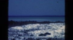 1950: a view of the sea shore at dusk with a storm approaching on the horizon  Stock Footage