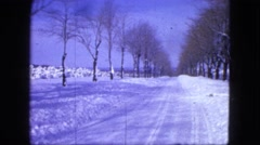 1963: snow covered road, house and landscape. MAINE Stock Footage