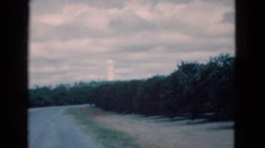 1950: an odd, white cylinder shaped structure reaching up into a cloudy sky Stock Footage