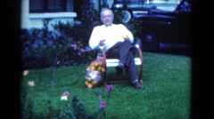 1950: older man sitting on the lawn with a bag of oranges FLORIDA Stock Footage