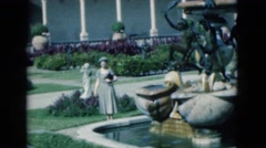 1950: a woman admiring an ornate water fountain in a beautiful courtyard FLORIDA Stock Footage