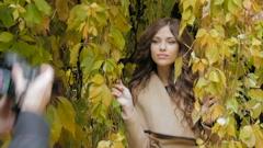 Beautiful model posing for photos Stock Footage