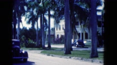 1950: a beautiful, palm tree lined street in a wealthy neighborhood FLORIDA Stock Footage
