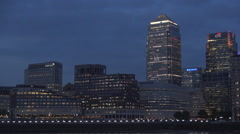 Thames River Dock in Canary Wharf District and Buildings Facade in Night Lights. Stock Footage