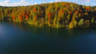 Autumn nature aerial landscape flight over lake and brightly colored forest. Stock Footage