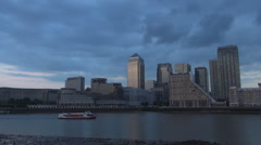 Boat Sailing on Thames River in Canary Wharf Dock Zone and Skyscrapers View. Stock Footage