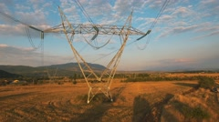 Electricity pylons at sunset aerial view.  Stock Footage
