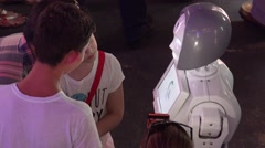 People talking with intellectual robot humanoid Stock Footage