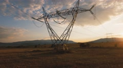 Electricity pylons at sunset Stock Footage