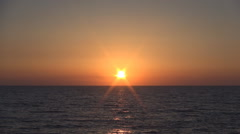 Red Sun Goes Down in Sea in a Gloaming Sea Seascape. Stock Footage