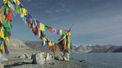 Tibetan prayer flags at Pangnong lake,Pangong,Ladakh,India Stock Footage