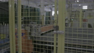 Glass manufacturing machines in cage Stock Footage