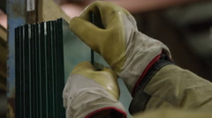 Workers and gloves moving panes of glass - safety Stock Footage
