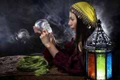 Psychic Holding a Crystal Skull Stock Photos