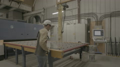 Worker on glass manufacturing line Stock Footage