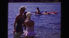 1961: women and girls splashing at a lake MINNESOTA Stock Footage