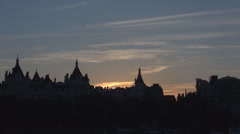Dark Silhouette of City of Westminster Building Roofs in Red Sunset Light in UK. Stock Footage
