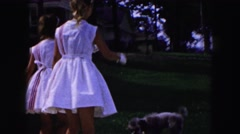1961: playing with our lovely pet mr.charlie in summertime MINNESOTA Stock Footage