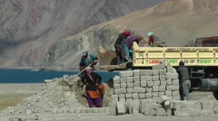 Workers loading sand on truck in himalaya,Pangong,Ladakh,India Stock Footage