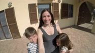 Happy family is turning around in the backyard. Sunny day. Stock Footage