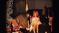 1961: a girl playing with her toys at christmas  Stock Footage