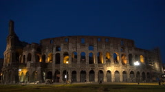 Time Lapse Night View with Tourists Visiting Lighted Colosseum Ruins in Rome. Stock Footage