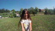 Young girl turning around in circles in the backyard  in spring or summer. Stock Footage