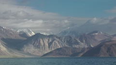 Timelapse of clouds over mountains at lake,Pangong,Ladakh,India Stock Footage