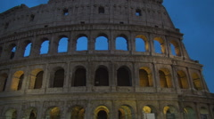 Colosseum Monument Largest Antique Amphitheatre with Walls Lighted at Nightfall. Stock Footage