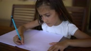 Closeup of pretty, long-haired young girl doing homework. Stock Footage