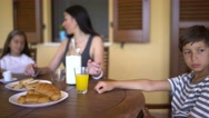Dolly shot of family having breakfast while the teen son is sad and jealous. Stock Footage