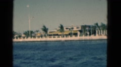 1950: a beautiful lake with sparkling blue water and shore having large building Stock Footage