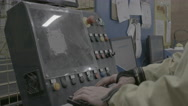 Worker with hands on console in factory Stock Footage