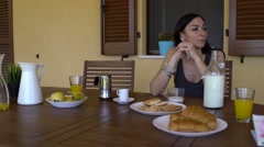 Worry, thoughtful woman standing alone at breakfast table. Stock Footage