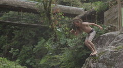 Slow motion extreme cliff diving in amazon jungle Stock Footage