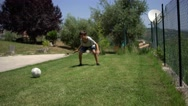 Young brothers or friends playing soccer in the backyard on the lawn, barefoot. Stock Footage