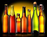 Set of beer bottles isolated on black background Stock Photos